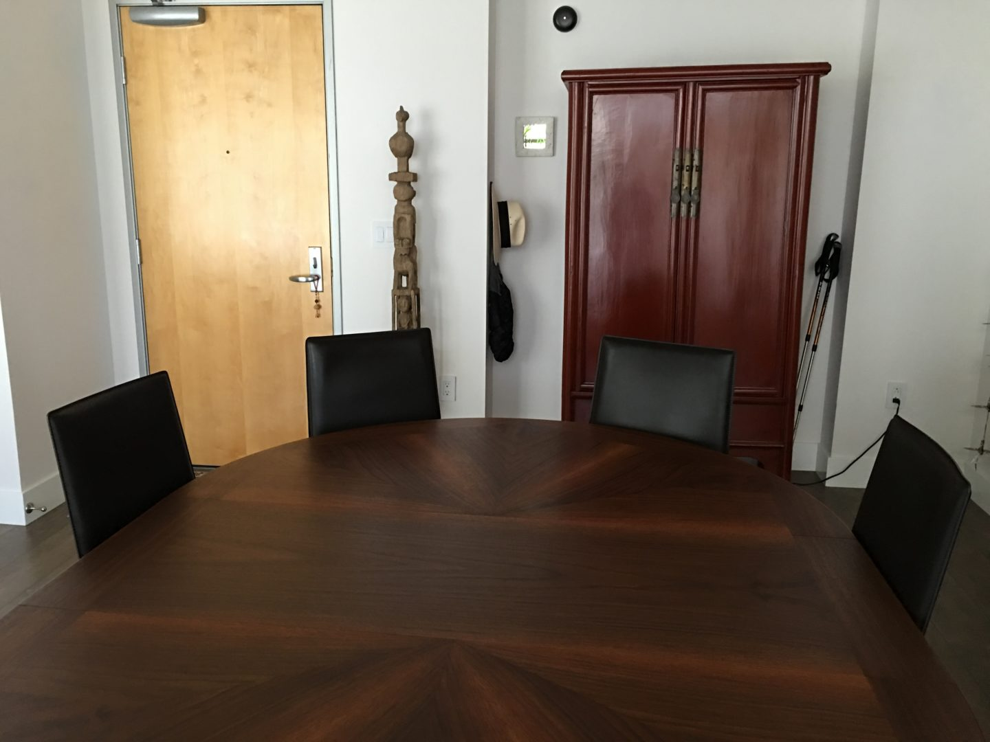 A dining table in a living room